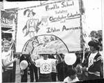 Students march with Franklin School salutes Columbus Day and Italian Americans banner in the Columbus Day Parade