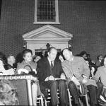 Hubert Humphrey waits to make a speech at a rally