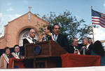 Ace Alagna, Danny Aiello and Robert Guy Torricelli at the podium on the dias of the 1995 Columbus Day Parade