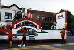 Miss Columbus Day waves from the Broad National Bank float in the 1995 Columbus Day Parade