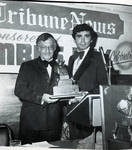 Buddy Fortunato presents the Italian Tribune News Journalistic Award to Anthony Zoppi during the 1976 Columbus Day Dinner