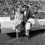 Couple at Grand Marshall's car  at the 1971 Columbus Day Stadium Gala