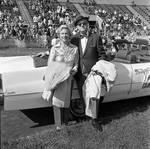 Couple at Grand Marshall's car  at the 1971 Columbus Day Stadium Gala