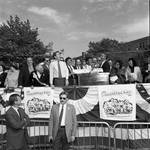 Frankie Avalon presented with a street sign as Congressman Peter W. Rodino Jr., Governor Thomas Kean and others laugh