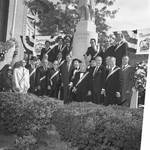 Governor Thomas Kean and others pose in front of the Columbus statue during the 1984 Columbus Day Parade