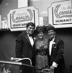 Columbus Day Dinner Buddy Fortunado and Frankie Avalon pose with a woman by Ace (Armando) Alagna, 1925-2000