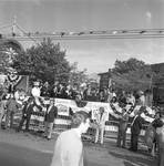 Geraldine Ferraro waves from the dias at the 1984 Columbus Day Parade