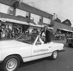 Miss Columbus Queen 1984 rides in the Columbus Day Parade