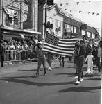 Children hold the flag aloft in the Columbus Day Parade