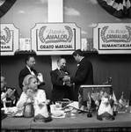 Ace Alagna and Buddy Fortunado present an award at the Columbus Day Parade Dinner by Ace (Armando) Alagna, 1925-2000