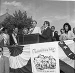 Governor Thomas Kean speaks as Frankie Avalon, Ace Alagna and others listen at the 1984 Columbus Day Parade