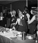 Miss Columbus Day and others applaud Grand Marshall Donato Rizzolo at the 1972 Columbus Day Dinner