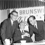 Governor Richard Hughes looks on as Vice President Hubert Humphrey  shakes hands
