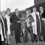 Governore Hughes, Vice President Hubert Humphrey  and others pose with a cow during 1966 tour of New Jersey