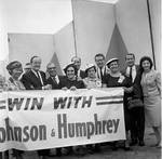 Vice President Hubert Humphrey  and supporters pose with a Win with Johnson &  banner during 1966 tour of New Jersey