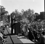 Side view of Vice President Hubert Humphrey  delivering a speech to the crowd during 1966 tour of New Jersey