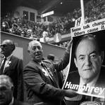 Holding a Hubert Humphrey poster at the 1968 Democratic National Convention, Chicago, Illinois