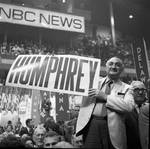 Holding a Humphrey sign at the 1968 Democratic National Convention, Chicago, Illinois