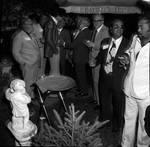 Frank Longella  talking with group of men