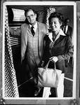 Brendan T. and Jean Featherly Byrne in front of a voting booth