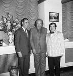 Mitch Miller standing with two men