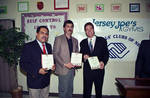 Joe Piscopo, Mayor Sharpe James and Captain Thomas Brennan holding awards at Boys and Girls Club event