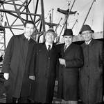 Peter W. Rodino poses with others in front of a ship
