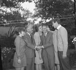 Peter W. Rodino shakes hands