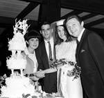 Eydie Gorme and Steve Lawrence with bride and groom cutting the cake at Westwood Restaurant
