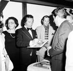 Al Martino autographs an album for fans