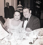 Richard Tucker at table with a woman