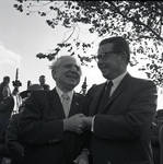 Governor Richard Hughes shakes hands during a visit to Liberty Island for signing of the 1965 Immigration Bill
