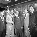 Brendan Byrne shakes hands in front of Don's 21