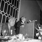 Robert Meyner laughs as Peter Rodino speaks at a North Ward Democratic Country Commission political event at the Robert Treat Hotel, Newark NJ
