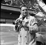 Ace Alagna poses with his camera by Ace (Armando) Alagna, 1925-2000