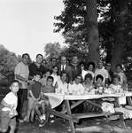 Essex County Sheriff Ralph D'Ambola takes a picture with a large group of guests at a picnic bench by Ace (Armando) Alagna, 1925-2000