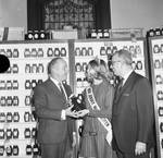 NJ Governor William T. Cahill receives a jar of honey from the New Jersey Honey Queen and Phil Albi