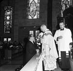 New Jersey Governor Richard and Mrs. Hughes receiving Communion at the Mass for his inauguration