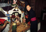 Monsignor Joseph Granato in front of the Christmas cr�che