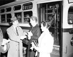 Peter W. Rodino shaking hands with woman coming off No. 18 bus in Newark, NJ