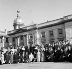 Assemblyman (Marvin D. ?) Perskie with large group of visitors in front of State House