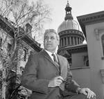Sam Wito posing in front of State House
