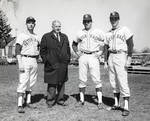 Baseball coach Owen Carroll with Larry Ravelstad, Bob Sparks and unknown player