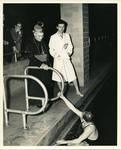 Archbishop Walsh supervising swimmers at Walsh Gym