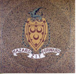 "Hazard Zit Forward"""" seal in the foyer of McLaughlin Library"